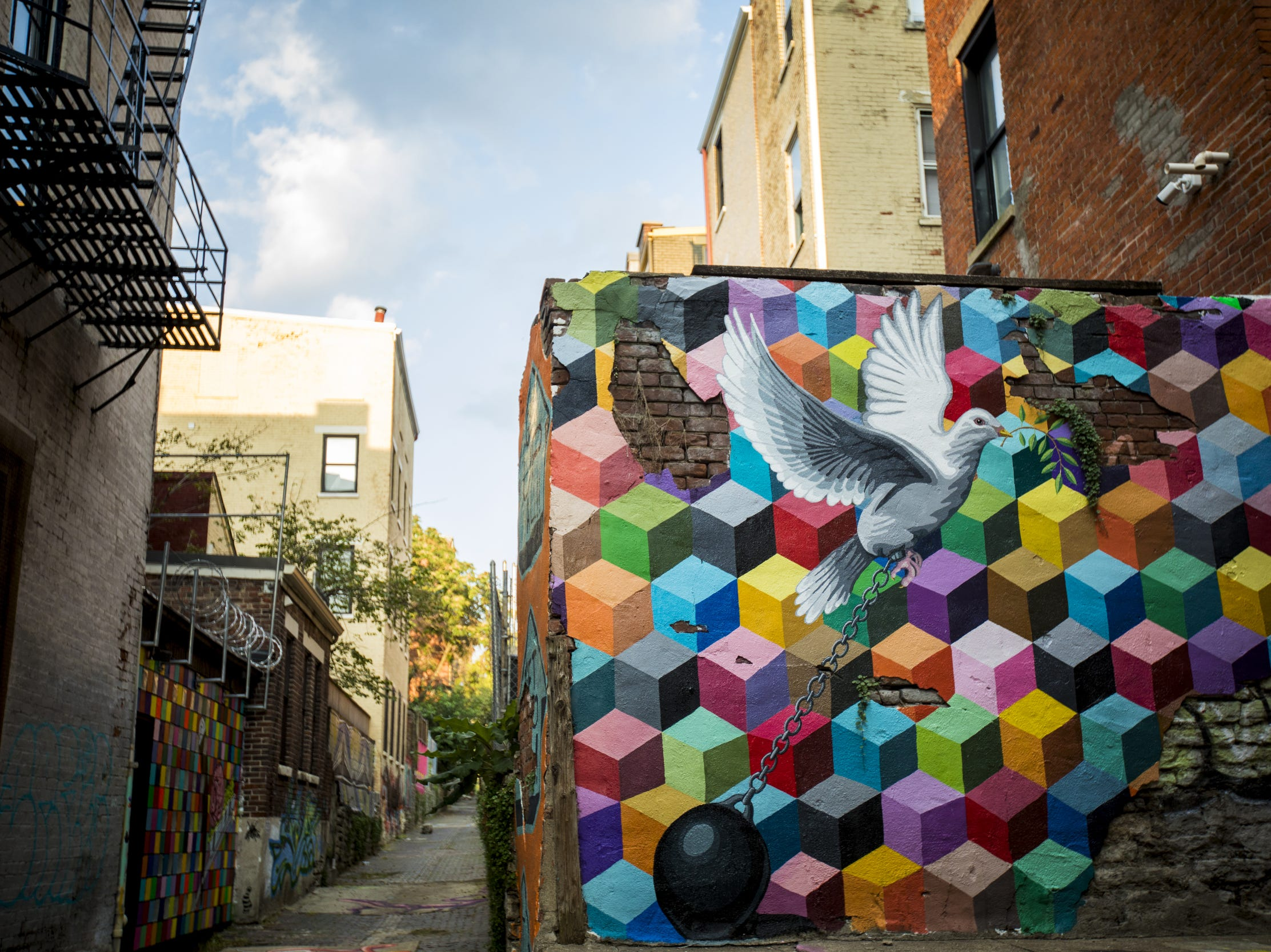 """Get up YALL!"" designed by Leon Reid IV is featured in Bolivar Alley in Pendleton as part of New Lines Alleyway Murals: Phase II by ArtWorks."