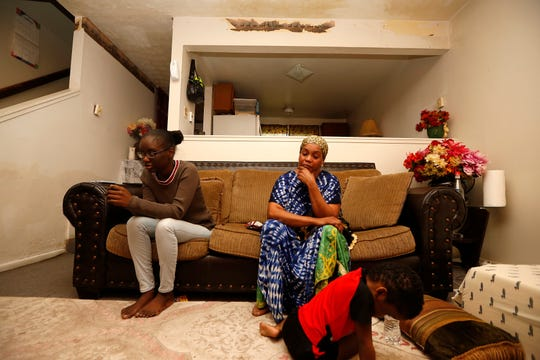Awa Harouna, 23,  left, with her mother Aissata Aly, as Aly's youngest child Muhammad Sow, 3, plays, in their Lockland home. The family received good news Jan. 4, when the Board of Immigration appeals granted Amadou Sow, Aly's husband, a temporary stay of deportation.