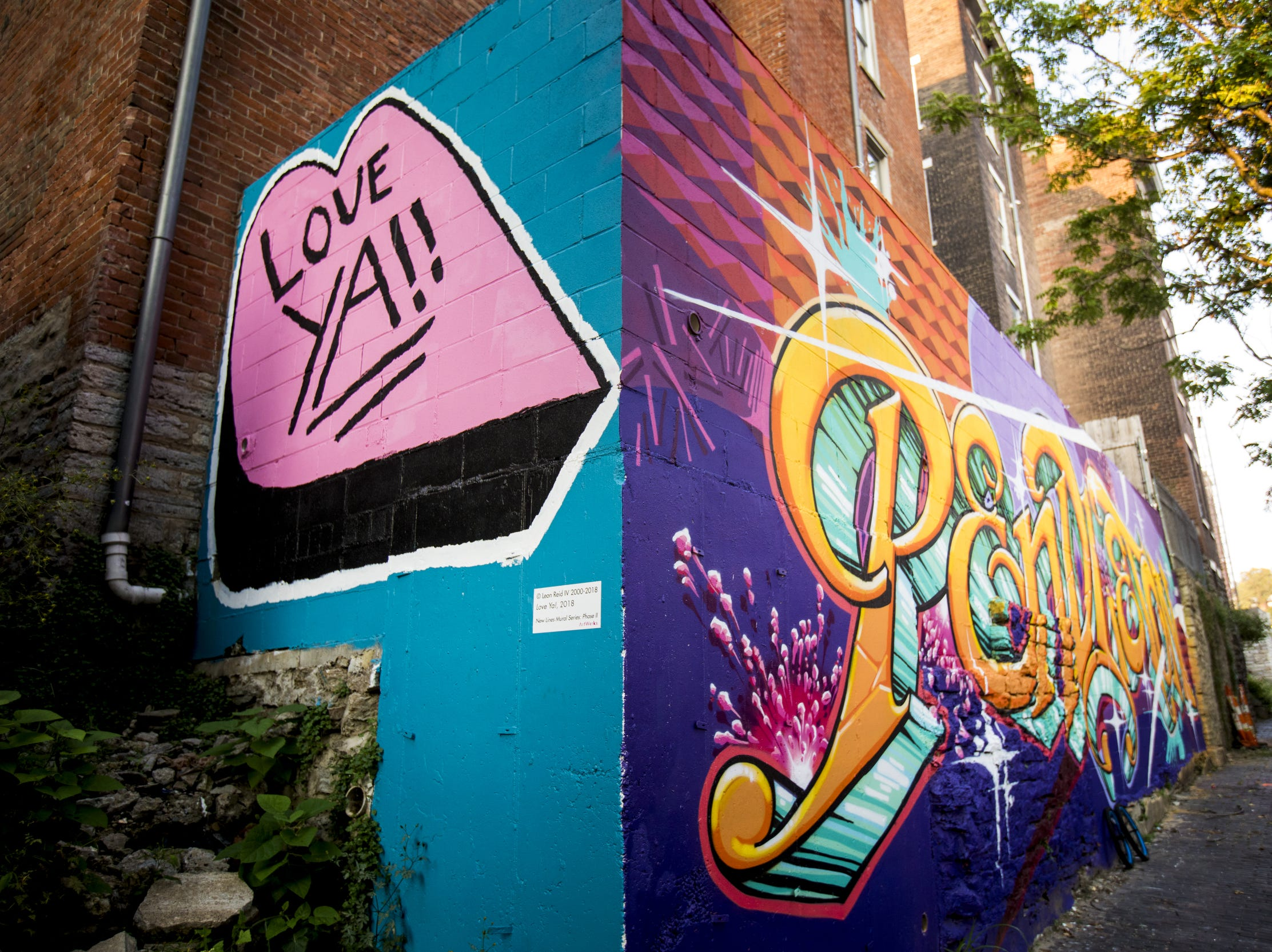 Wednesday, September 19, 2018: ÒLove Ya!!Ó designed by Leon Reid IV is featured in Bolivar Alley in Pendleton as part of New Lines Alleyway Murals: Phase II by ArtWorks.