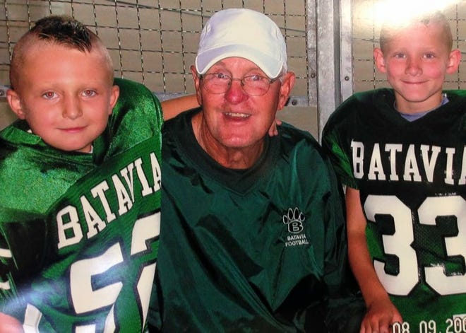 Kaleb Moell (right) with his grandfather Ken Osborne after a youth football game.