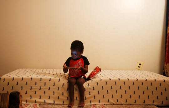 Muhammad Sow, 3, watches a video from his mother's cell phone at their Lockland home Friday, October 5, 2018. Muhammad has seen his father Amadou Sow since August after he was taken into custody by ICE. Amadou Sow, was born in Mauritania but has lived in the U.S. for 30 years and worked at a manufacturing company for 20 years in Lebanon, is in danger of being deported back to Mauritania. The United Nations says Mauritania that Muslim and ethnic black minority men are being trafficked into slavery and sold in Libya.