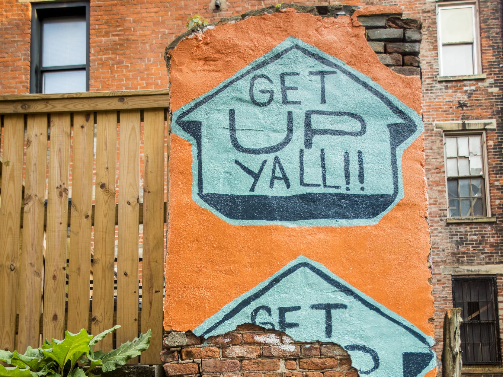 Wednesday, September 19, 2018: ÒGet up YALL!Ó designed by Leon Reid IV is featured in Bolivar Alley in Pendleton as part of New Lines Alleyway Murals: Phase II by ArtWorks.
