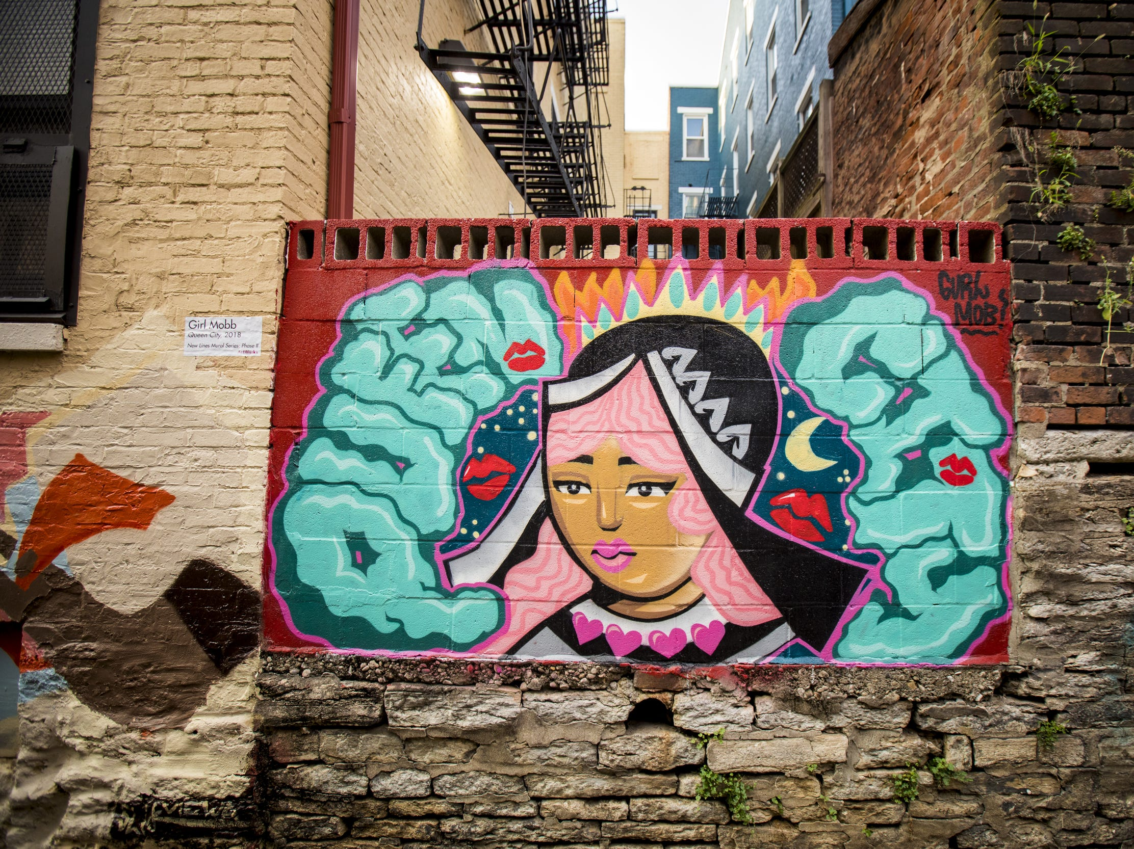 Wednesday, September 19, 2018: ÒQueen CityÓ designed by Girl Mobb is featured in Bolivar Alley in Pendleton as part of New Lines Alleyway Murals: Phase II by ArtWorks.