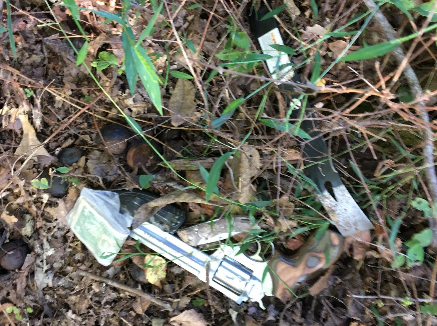 A gun, a crowbar and cash found during the arrest of Kirby Wallace.