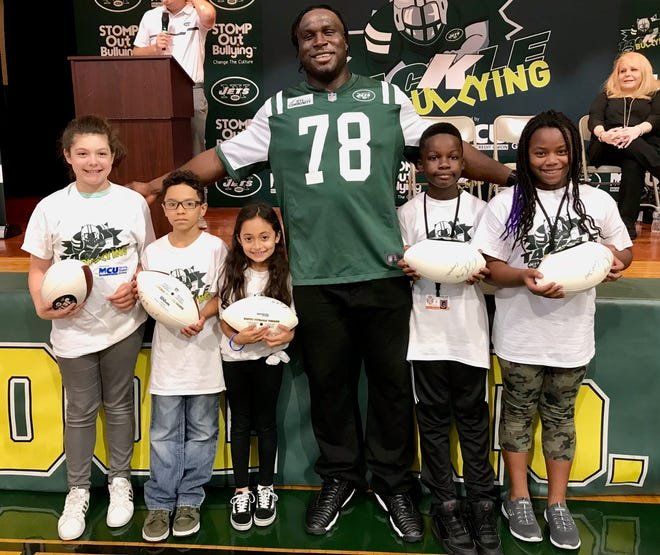 New York Jets lineman Jonotthan Harrison with the all of the Linden School No. 5 Upstanders of the Week for this school year. From left are Alice Dasilva, Bret Alicea, Ariana Cestona, Calen Brown, and Savonne Johnson.