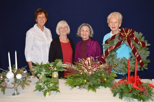 (Left to right) Designers for this year's Neshanic Garden Club workshop: Diana Reinhardt, Carmella Shepley, Arline Pagliaro, and Jean Stives. Not pictured is Georgette Migliore. The designs, also from left to right are the Silver Petal Design, Christmas Trio, Victorian Style Design, Christmas Wreath, and Tapered Candle Centerpiece.