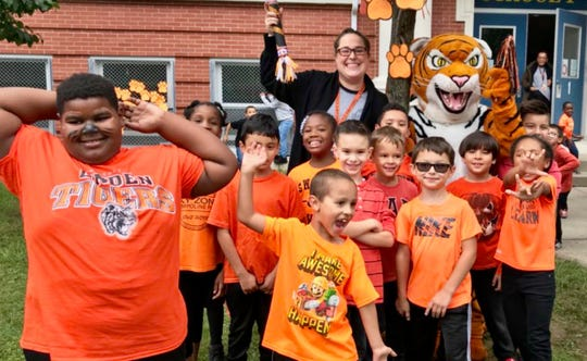 """Linden Public Schools celebrated their first Tiger Spirit Day of the year on Sept. 28, when everyone was invited to show their stripes by wearing their favorite Linden apparel or anything orange and black. Many staff members wore their """"Together We Can"""" T-shirt, which they received at the district Launch that kicked off the school year. The Tiger is the mascot for all of Linden's 11 public schools."""