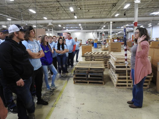 Susan McPherson in human resources at Annin Flagmakers conducts a tour with a group of students from Coshocton High School for Manufacturing Day.