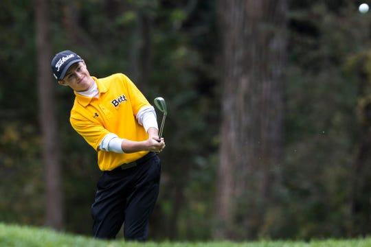 Bettendorf's Matthew Garside hits onto the green during the first day of boy's state golf on Friday evening, Oct. 5, 2018, at Brown Deer Golf Course in Coralville, Iowa.