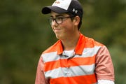 Cedar Rapids Prairie's Ian Johnston smiles after sinking a putt during the first day of boy's state golf on Friday evening, Oct. 5, 2018, at Brown Deer Golf Course in Coralville, Iowa.