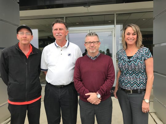The management team of Gregg Young Buick GMC: Tony Kirsch, Service Manager; Bob Shelton, Parts Manager; Sean O'Leary, General Manager; Mindy Kauzlarich, Office Manager.