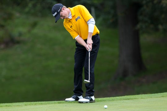 Bettendorf's Matthew Garside putts during the first day of boy's state golf on Friday evening, Oct. 5, 2018, at Brown Deer Golf Course in Coralville, Iowa.