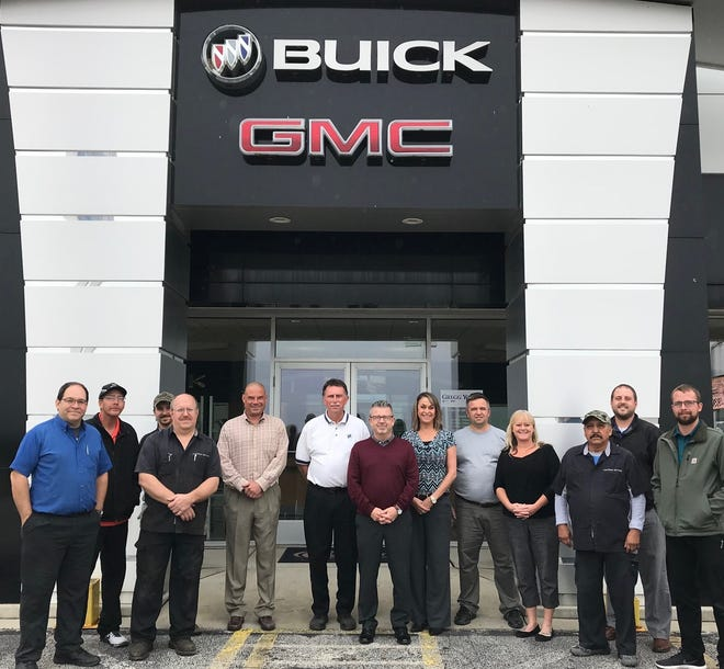 Watters Buick GMC has been sold to Gregg Young of Omaha. Sean O'Leary (center) is stepping in as general manager. All 20 employees are expected to stay with the company.
