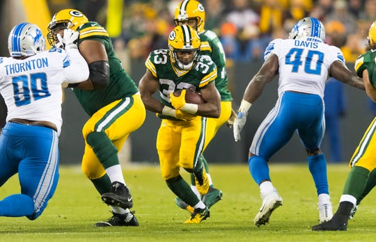Packers running back Aaron Jones carries the ball during the first quarter against the Lions last season.