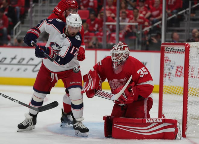 Jimmy Howard blocks a shot by Blue Jackets center Brandon Dubinsky during the second period of the Wings' 3-2 overtime loss to the Blue Jackets on Oct. 4 at Little Caesars Arena.