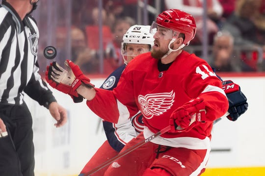 Defenseman Filip Hronek is on his way back to the Red Wings.
