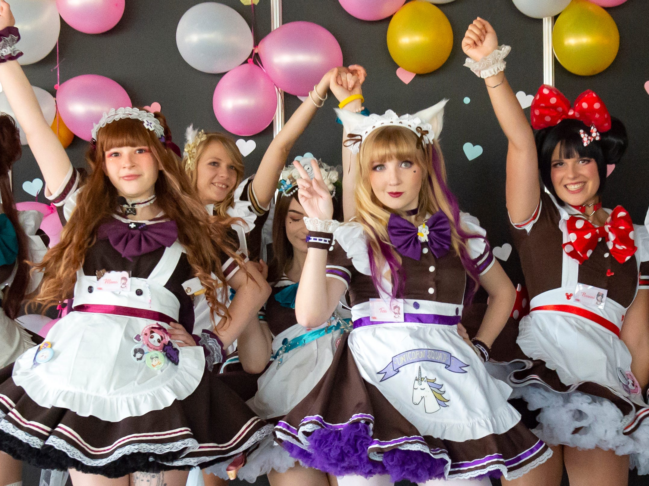 """Artists of thje """"Maidcafe"""" dance perform at the community event MAG in Erfurt, central Germany, Friday, Oct. 5, 2018. Occupying an area of 96,875 square feet, the show attracted 117 exhibitors from the areas of games, cosplay, creator, artists, Japan, fashion and merchandise until Sunday."""