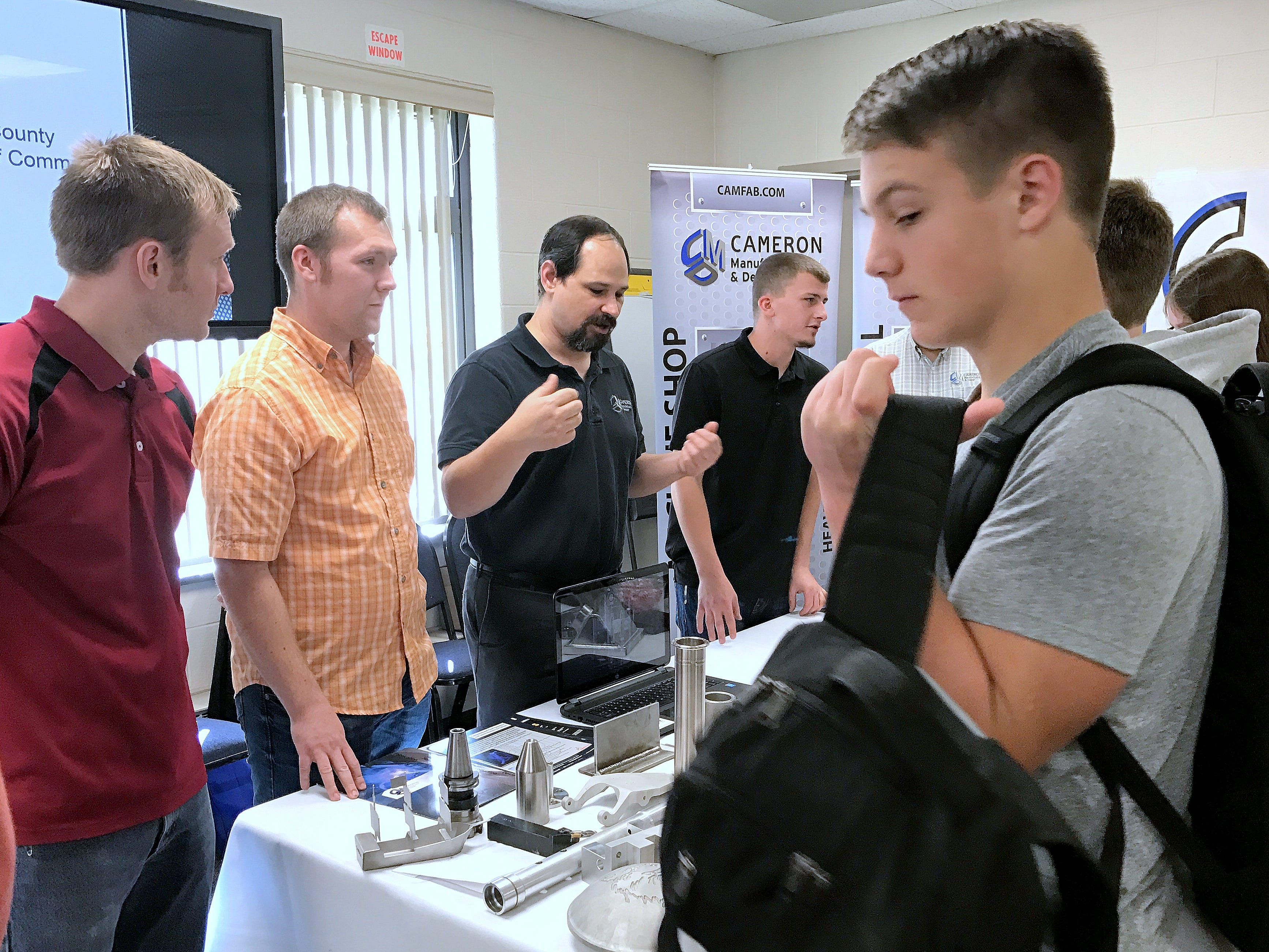 Representatives from Cameron Manufacturing talk with students about their products during Manufacturing Day on Friday at the Greater Southern Tier BOCES Bush Campus in Horseheads.
