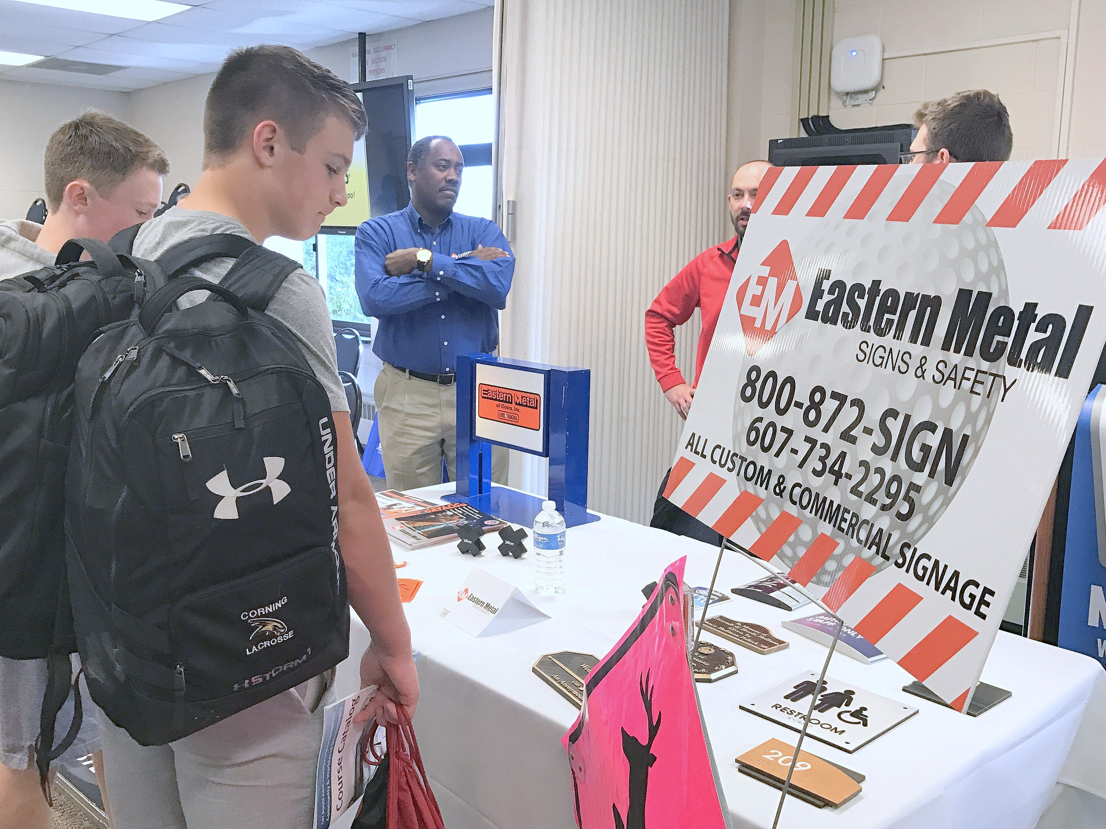 Local students check out the Eastern Metal display Friday during Manufacturing Day at the BOCES campus in Horseheads.