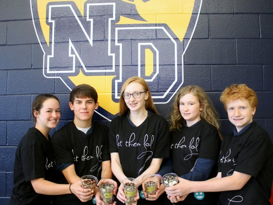 Notre Dame High School students Kathryn Gough, left, Brandon Hibbard, Caroline Rogers, Natalie Susch and Neal  Moore are among those raising money for people in a tiny village in Sierra Leone, Africa.