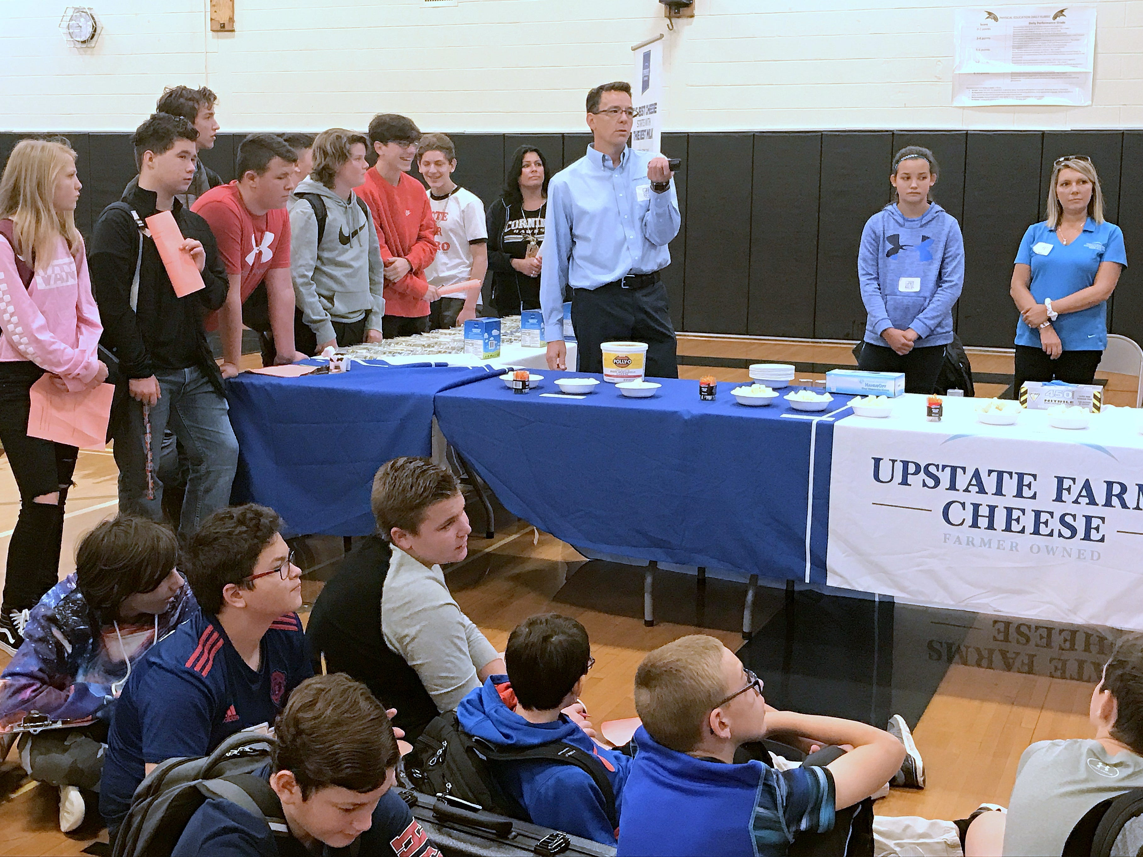 Students from Corning-Painted Post Middle School listen to a presentation by Upstate Farms on Friday during a Manufacturing Day event at the school.