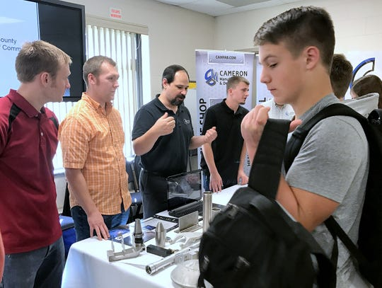 Representatives from Cameron Manufacturing discuss their products and job opportunities with students Friday during a National Manufacturing Day event at the Greater Southern Tier BOCES campus in Horseheads.