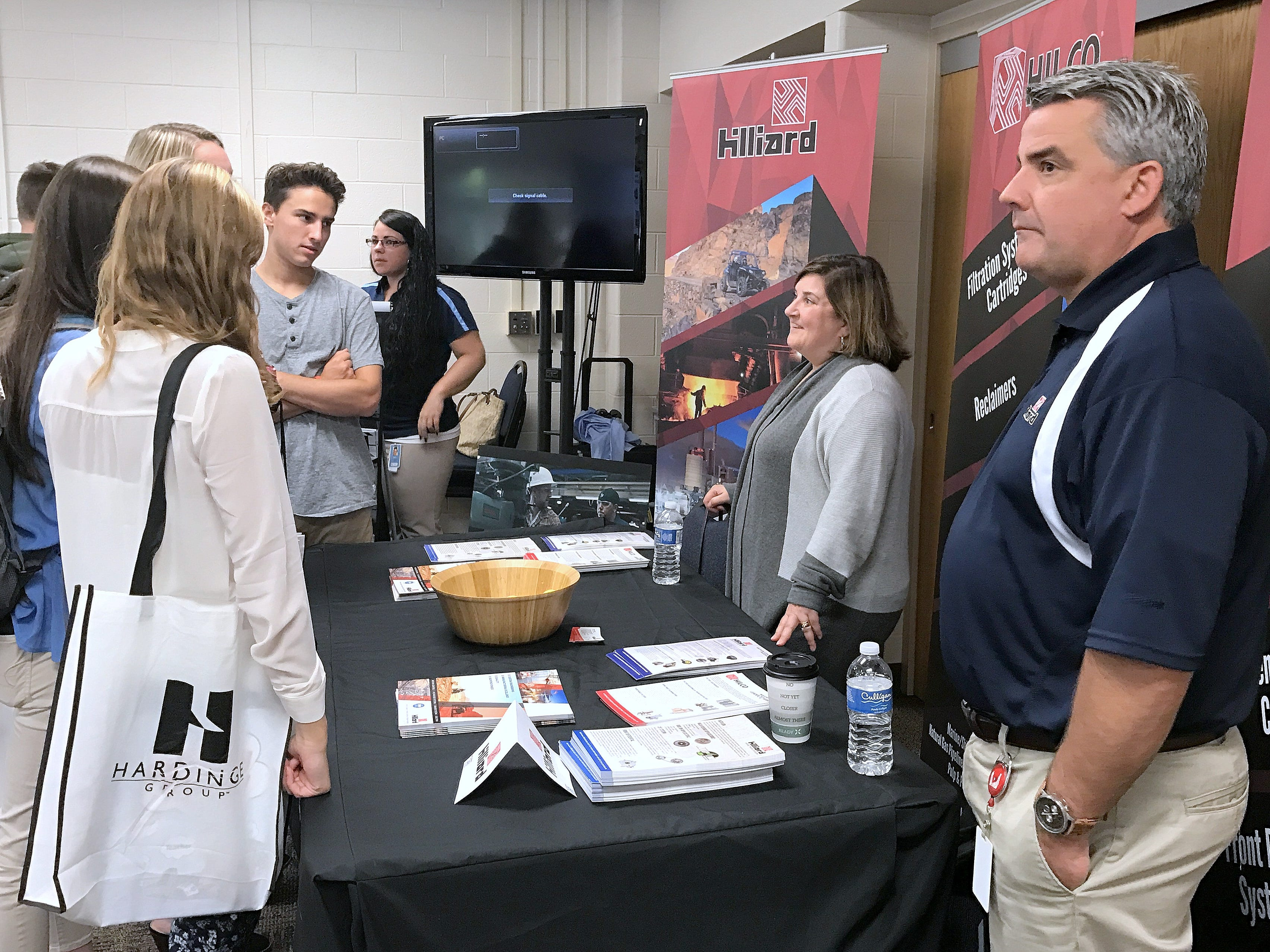 Students check out the Hilliard Corp. display Friday during Manufacturing Day at the Greater Southern Tier BOCES Bush Campus in Horseheads.