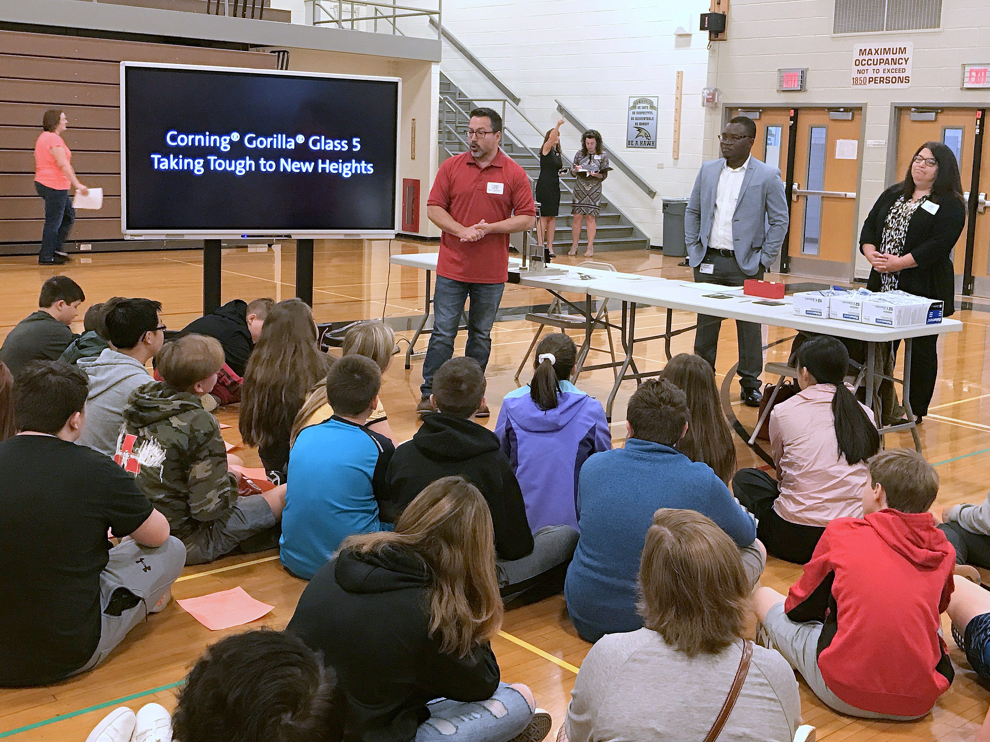 Ben Stevens from Corning Inc. discusses the Gorilla Glass product line with students at Corning-Painted Post Middle School on Friday for Manufacturing Day.