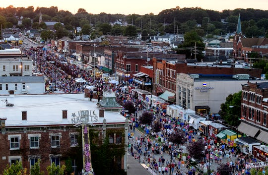 People fill Evansville's West Franklin Street as they search for tasty treats from over 130 booths at the 97th annual West Side Nut Club Fall Festival, Wednesday, Oct. 3, 2018.