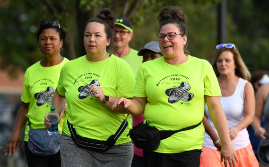 Erica Leavell , left, and Jena Ashlock head out for a training run as members of Team 13 train for the Evansville Half Marathon Thursday, October 4, 2018.