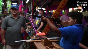 """Denis Miller and his family have been running the """"Shoot Till You Win"""" cork gun gallery at the Fall Festival since 1962."""