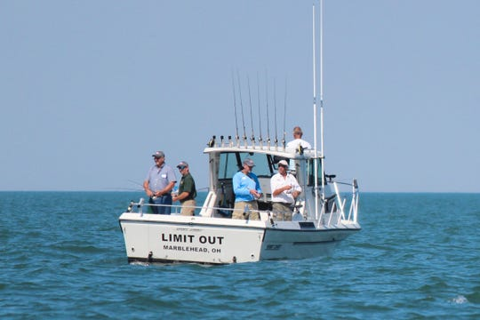 Tourists fish off  this charter boat, Limit Out, captained by Pat Winke of Winke Guide Service. Charter boat captains in Ottawa County said there was a decline in business this year due to algal blooms on Lake Erie that started in mid-June and peaked in July.