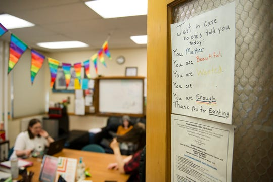 A sign of encouragement hangs on the door of the Rainbow Resource Center at the University of Wyoming in Laramie on Thursday, October 4, 2018. The room, located in the student union, is covered with messages of courage and love for the LGBTQ+ community in Wyoming.