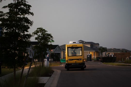 Jason Perez, an attendant on the driverless school bus shuttle at the town of Babcock Ranch takes the shuttle on a run before picking up students that attend the Babcock Ranch Neighborhood School on Friday morning.