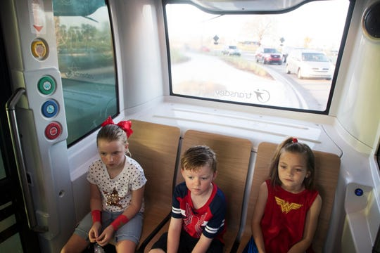 From left Babcock Ranch residents, Kayla Gray, Evan Gray and Molly Murphy ride the driverless shuttle to Babcock Ranch Neighborhood School on Friday 10/5/2018. The shuttle has an attendant who is there for emergencies and can over ride the vehicle in the event of obstacles.