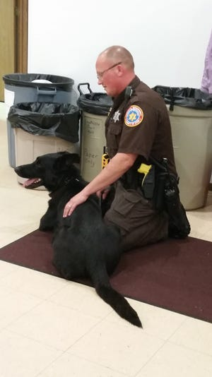 Officer Mark Tassoul poses with his new partner, police dog Odinn, at a community demonstration in Maplewood in late September. Odinn is the first police dog in Door County in more than 30 years.