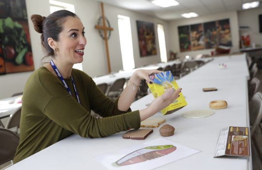 Liliana Ramirez, nutrition educator for Brown County's University of Wisconsin-Extension's FoodWIse program, speaks to clients about the importance of whole grains during a short class Thursday at Manna for Life Ministries in Green Bay.