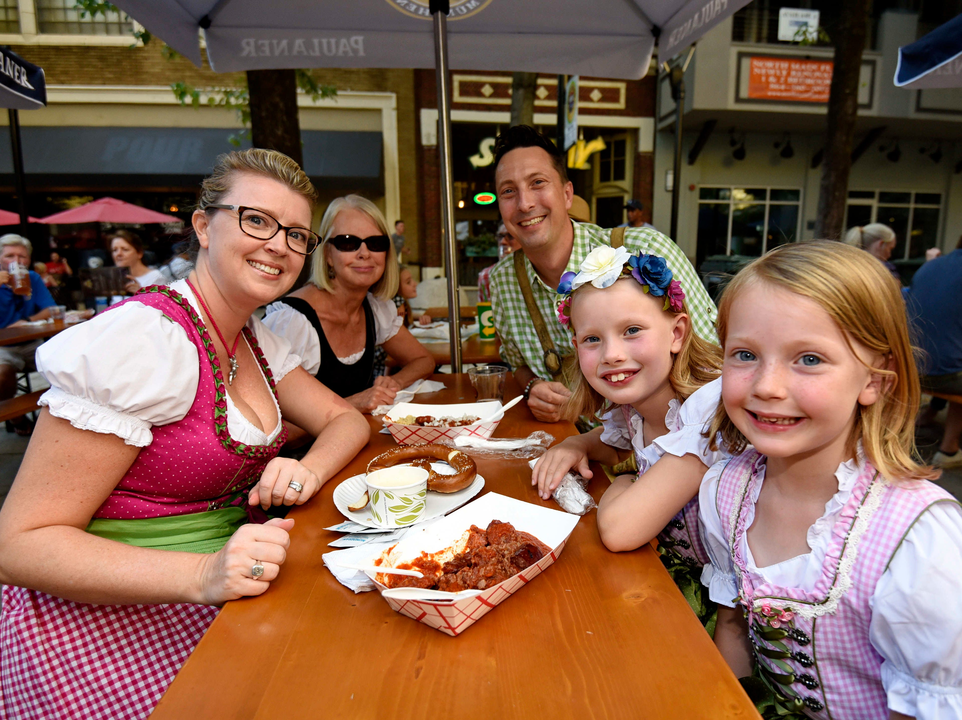 The Oehler family attend Oktoberfest which kicked off at NOMA Square in downtown Greenville Thursday, Oct. 4,  2018.