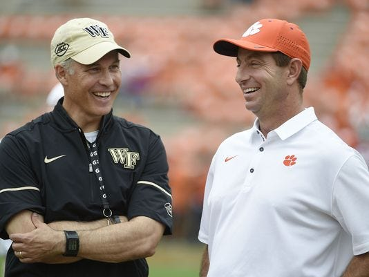 Wake Forest coach Dave Clawson, left, and Clemson's Dabo Swinney share a laugh before the teams' 2017 meeting.