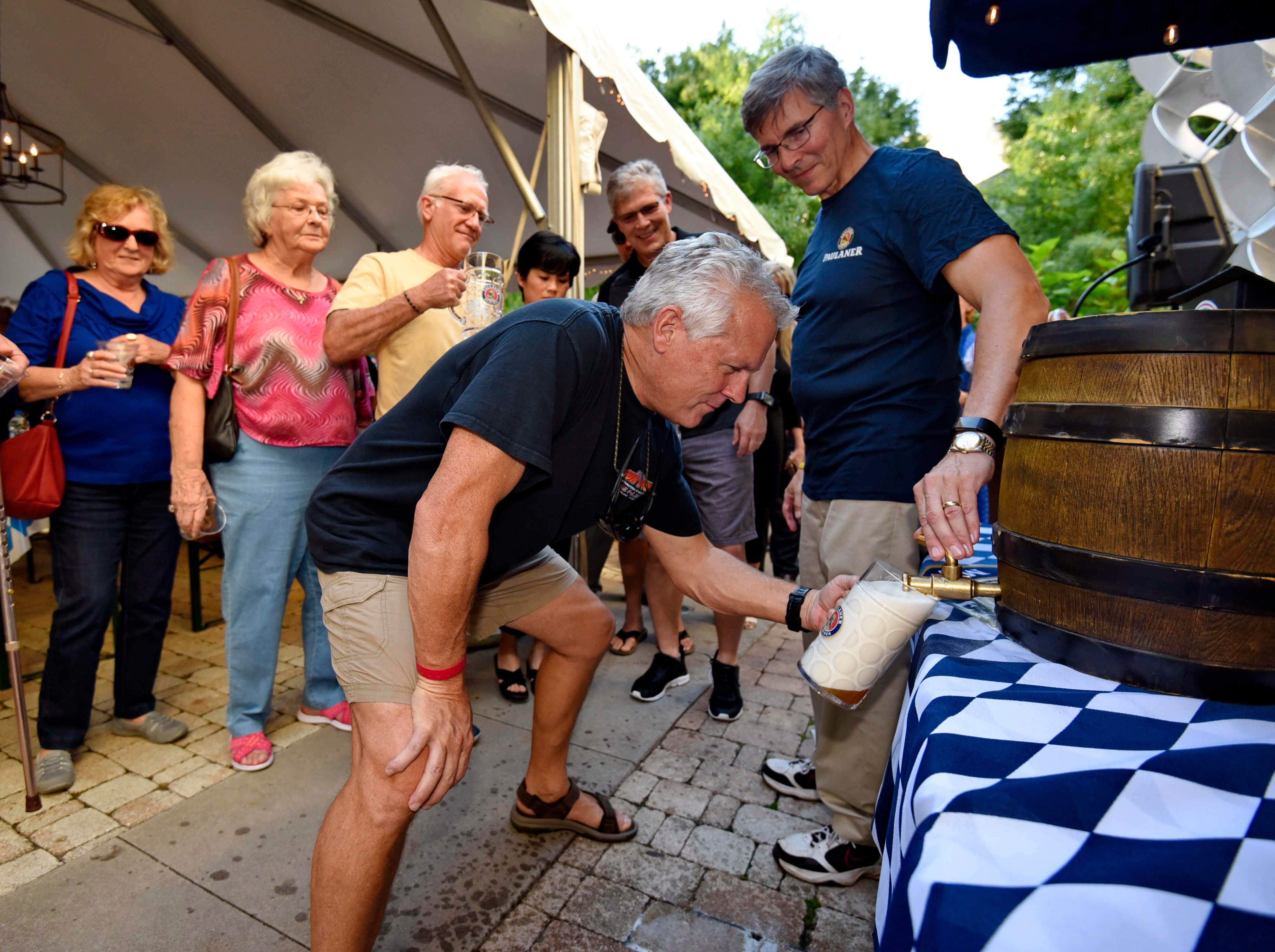 Jim Campisi pulls the first beer out of the official keg to kick off Oktoberfest at NOMA Square in downtown Greenville Thursday, Oct. 4,  2018.