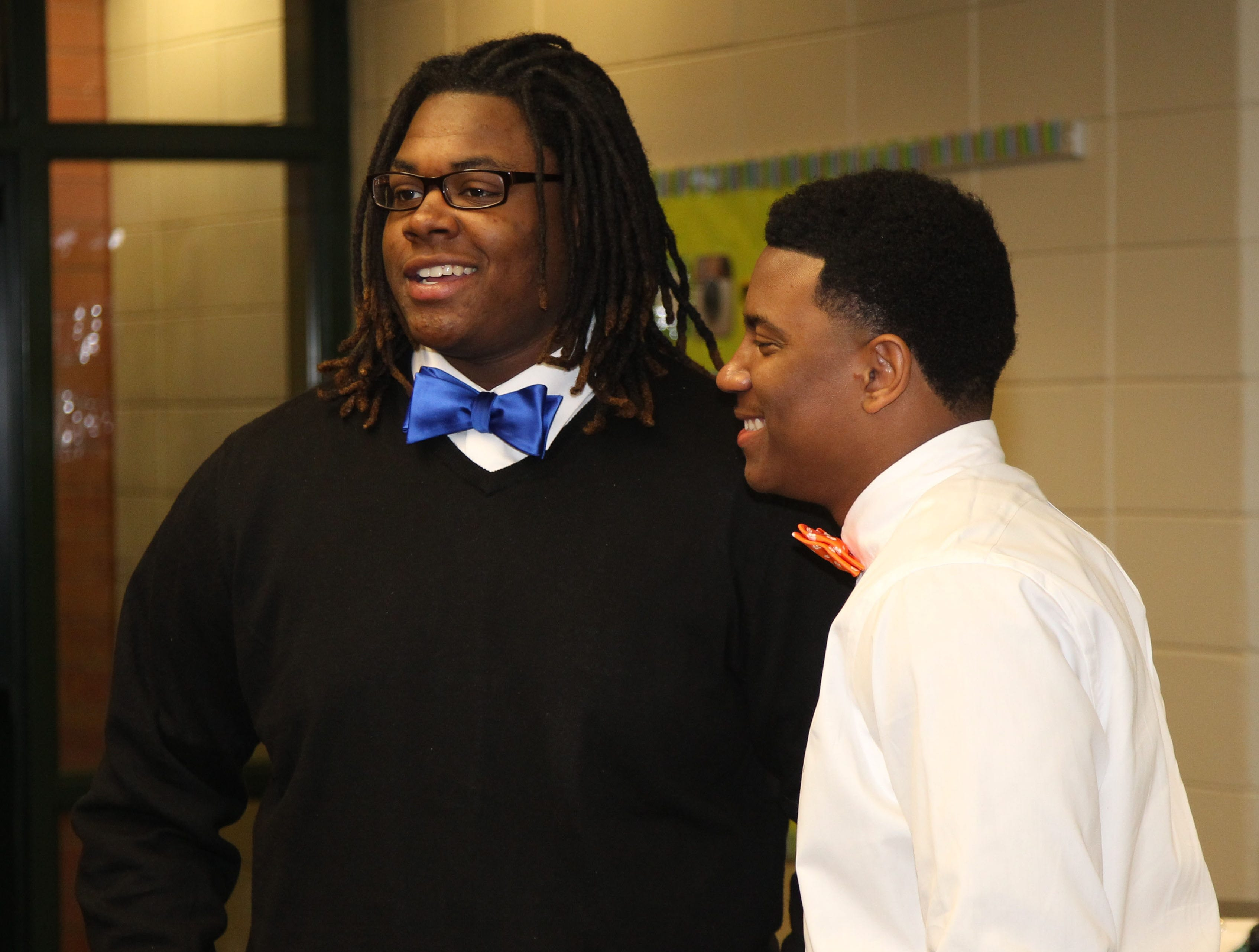 C.J. Fuller, right, participates in National Signing Day at Easley High School during his senior year.