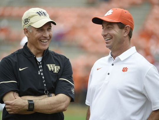 Wake Forest coach Dave Clawson (left) and Clemson's Dabo Swinney share a laugh prior to last year's game at Clemson.