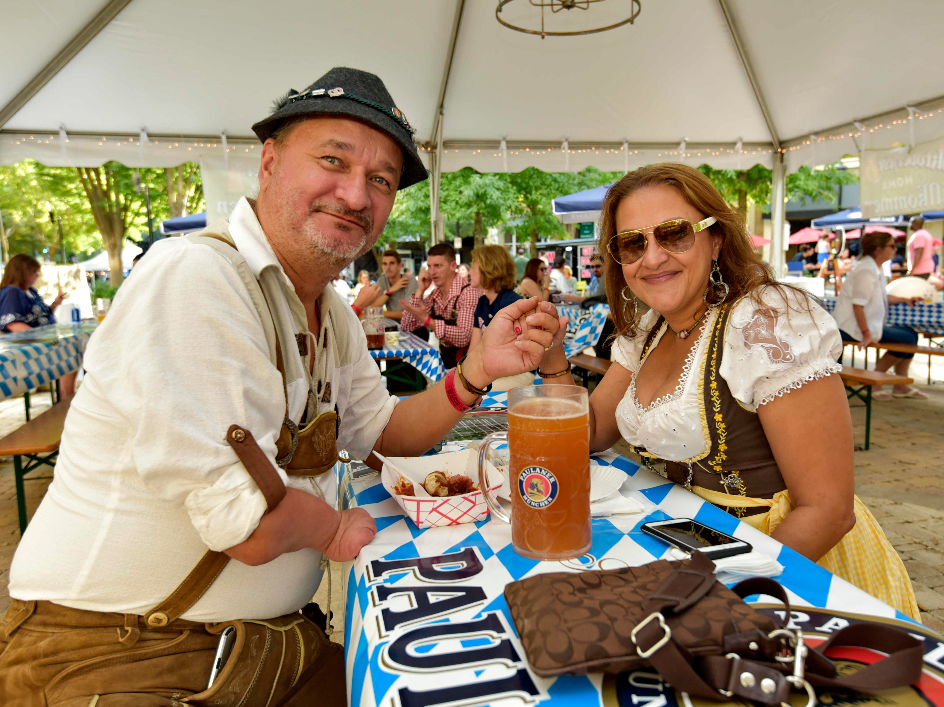 Michael and Daisy Gergolla attend Oktoberfest which kicked off at NOMA Square in downtown Greenville Thursday, Oct. 4,  2018.