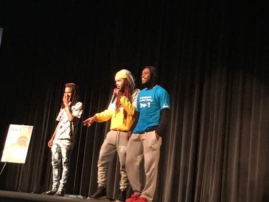 Hip-hop artist Dee-1, center, performs with Southside High School Friday morning.