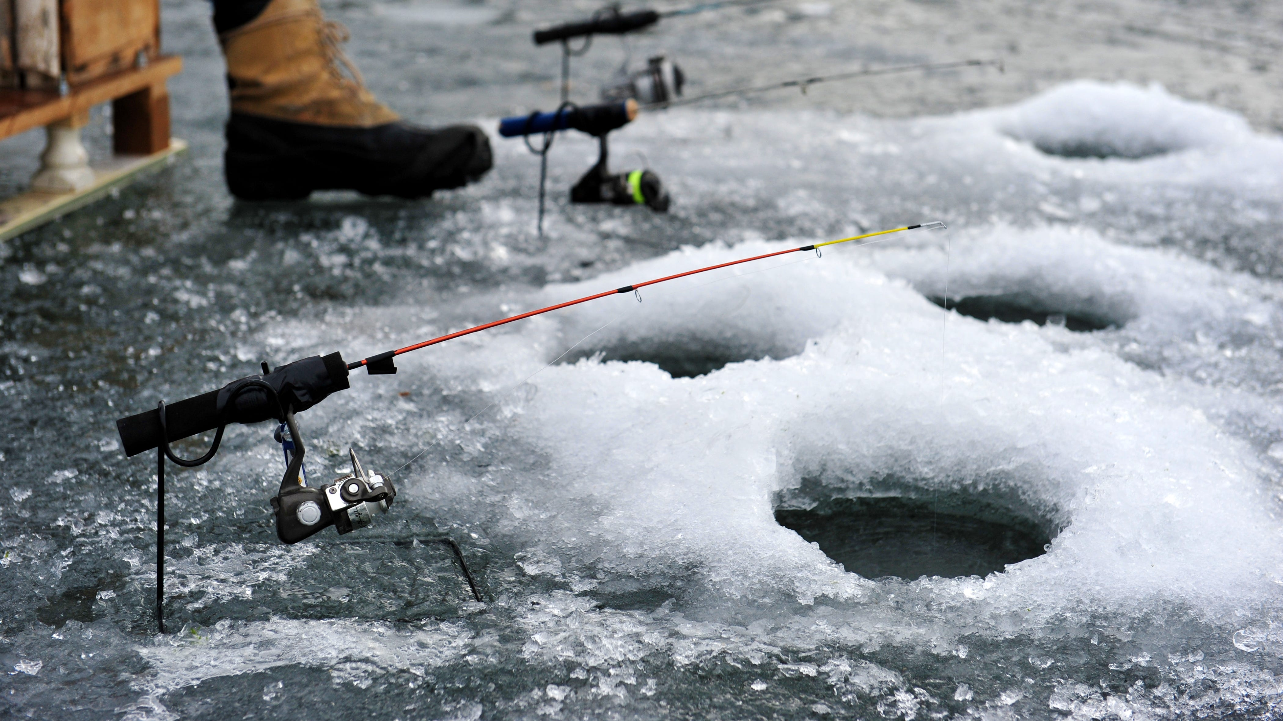 In this Tribune file photo, an angler patiently waits for a bite on one of his ice fishing poles at Holter Lake.