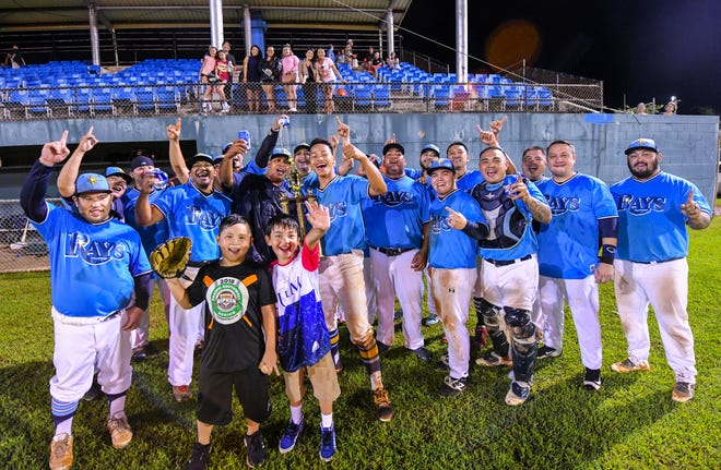 IT&E Rays players celebrate with family, fans and other supporters, after winning the Guam Major League Championship Series 4 games to 1 during action on the diamond at the Paseo Stadium in Hagåtña on Friday, Oct. 5, 2018.