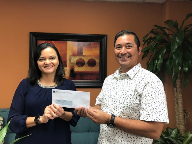 Guam Premier Outlets donated $800 on October 3 to the Rotary Club of Tumon Bay for their upcoming 17th annual Melbourne Cup. The annual fundraiser benefits various nonprofit organizations on island. Pictured from left: Suzanne Perez, GPO director of Marketing and Operations and Victor Camacho, Chairman for the annual Melbourne Cup.