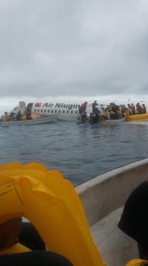 Locals and officials helped rescue passengers and crew from the Air Niugini flight that crashed into the Chuuk Lagoon on Sept. 28, 2018, after the plane came up short and missed the runway.