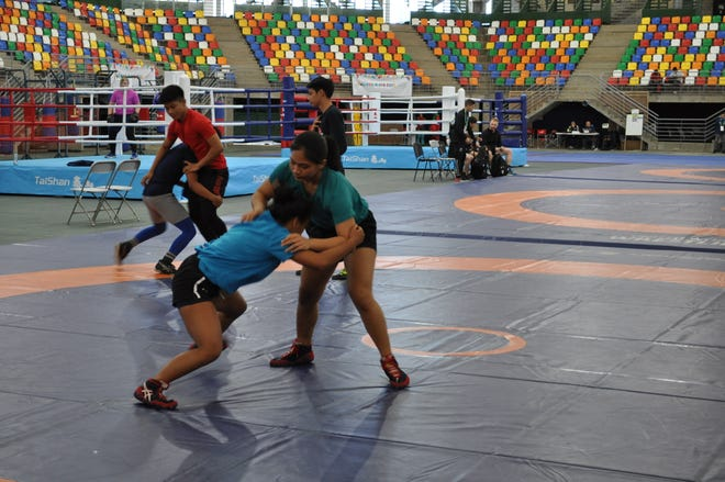 Four Guam wrestlers and a wrestler from Marshall Islands competing at the Youth Olympic Games in Buenos Aires, Argentina train on Oct. 4, 2018.
