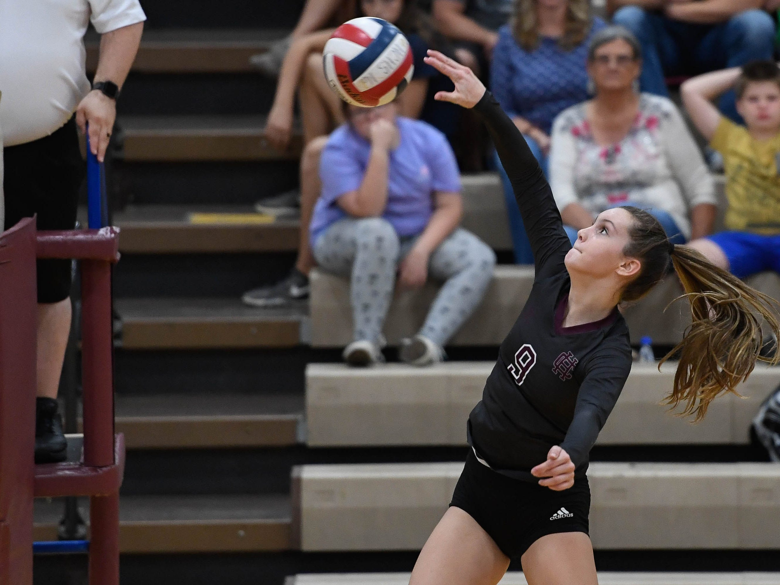 Henderson's Jordan Troutman (9) attacks as the Henderson County Lady Colonels play the Caldwell County Lady Tigers at Colonel Gym Thursday, October  4, 2018.